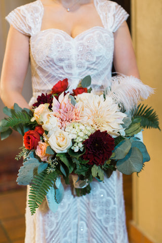 Bridal bouquet with feather by Gorgeous and Green for wedding Berkeley City Club