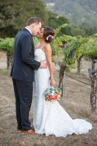 Bride and Groom in the grapevines, flowers by Gorgeous and Green in Napa Calistoga Hans Fahden Winery