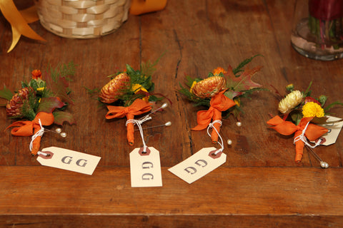 Boutonnieres in fall colors by Gorgeous and Green