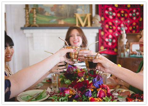 Beautiful ladies, food and flowers by Gorgeous and Green for Bridal shower on 100 layer cake