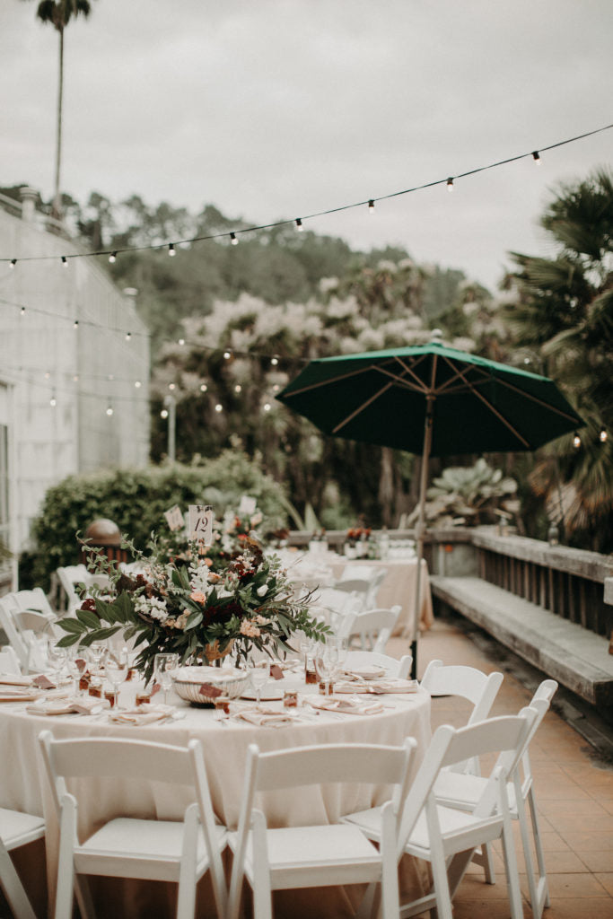 The outdoor patio at the reception adorned with tables and florals by G&G. Photo by From the Daisies.