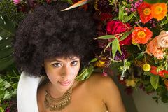 model with flower installation garden inspired bathtub in Oakland