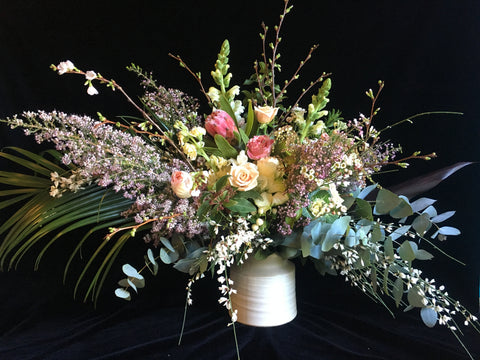 Wild and dramatic arrangement by Gorgeous and Green against a black velvet backdrop