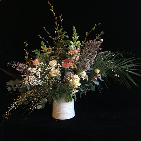 Wild arrangement by Gorgeous and Green against a black velvet backdrop