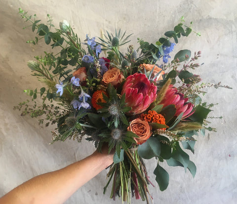 The Rustic protea and summer blooms bridal bouquet for a Yosemite wedding.