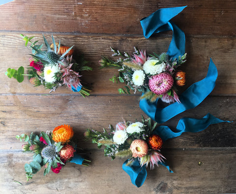 Yosemite rustic wedding wrist corsages and boutonnieres in teal and summer brights by Gorgeous and Green