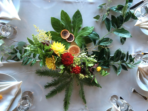 Wedding tablescape with citrus and leaves by Gorgeous and Green.