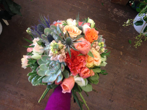 succulent and garden rose bridal bouquet in peach and coral and blue by Gorgeous and green