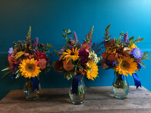 Bridesmaid bouquets with lots of color and pops of sunflowers by Gorgeous and Green