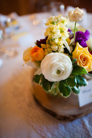 Closeup of a centerpiece with lovely local narcissus, ranunculus and more by Gorgeous and Green