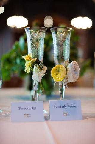 adorable champagne flutes adorned with flowers by Gorgeous and Green for wedding at Mill Valley Art Club