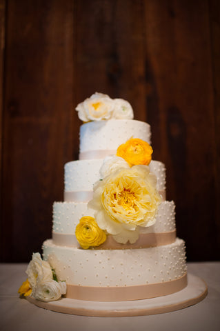 beautiful cake adorned with blooms by Gorgeous and Green for Mill Valley wedding