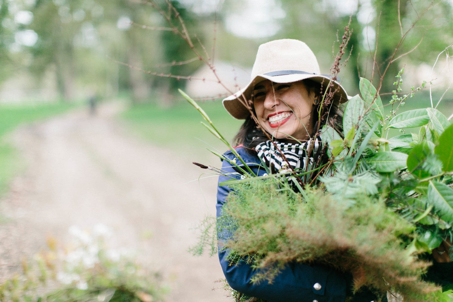 The owner, Pilar Zuniga foraging from the gardens at Wimborne St. Giles in England