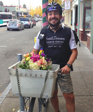 Pedal express with a flower delivery.