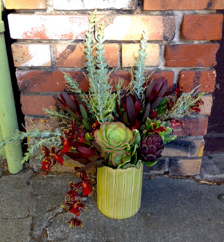 artichokes and succulents for an office arrangement