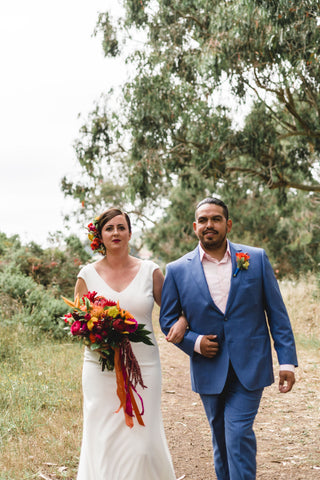 A shot of the Happy Couple for a wedding at the Marin Headlands with tropical bridal bouquet and boutonniere by Gorgeous and Green, Photo by C. Wagner Photography