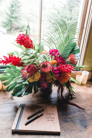 The Sign In arrangement of tropical flowers by Gorgeous and Green for a Marin Headlands Wedding, photo by C. Wagner Photography