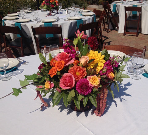 Colorful tuscan style arrangements for a wedding at St Vincent's School for Boys
