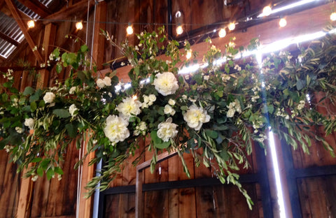 olive branch arch for a wedding by Gorgeous and Green