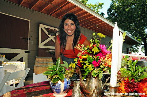 Pilar Zuniga, of Gorgeous and Green designing florals for an outdoor wedding at Diablo Ranch