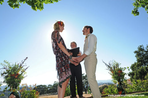 The couple at the Ceremony outside at Diablo Ranch, florals by Gorgeous and Green