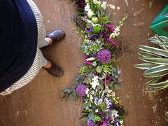 unique purple and green floral garland for an arch by Gorgeous and Green