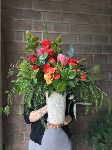 Large arrangement of foliage and bright blooms for Local delivery by Gorgeous and Green.