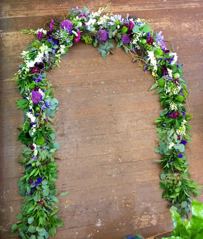 long floral garland for a wedding arch by Gorgeous and Green