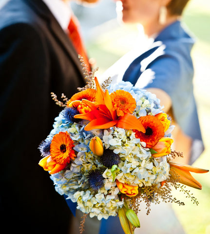 Bridal bouquet with blue and orange local grown flowers and textures by Gorgeous and Green