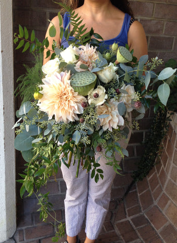 Oversized foliage, lotus and soft blush cafe au lait dahlia bridal bouquet by Gorgeous and Green