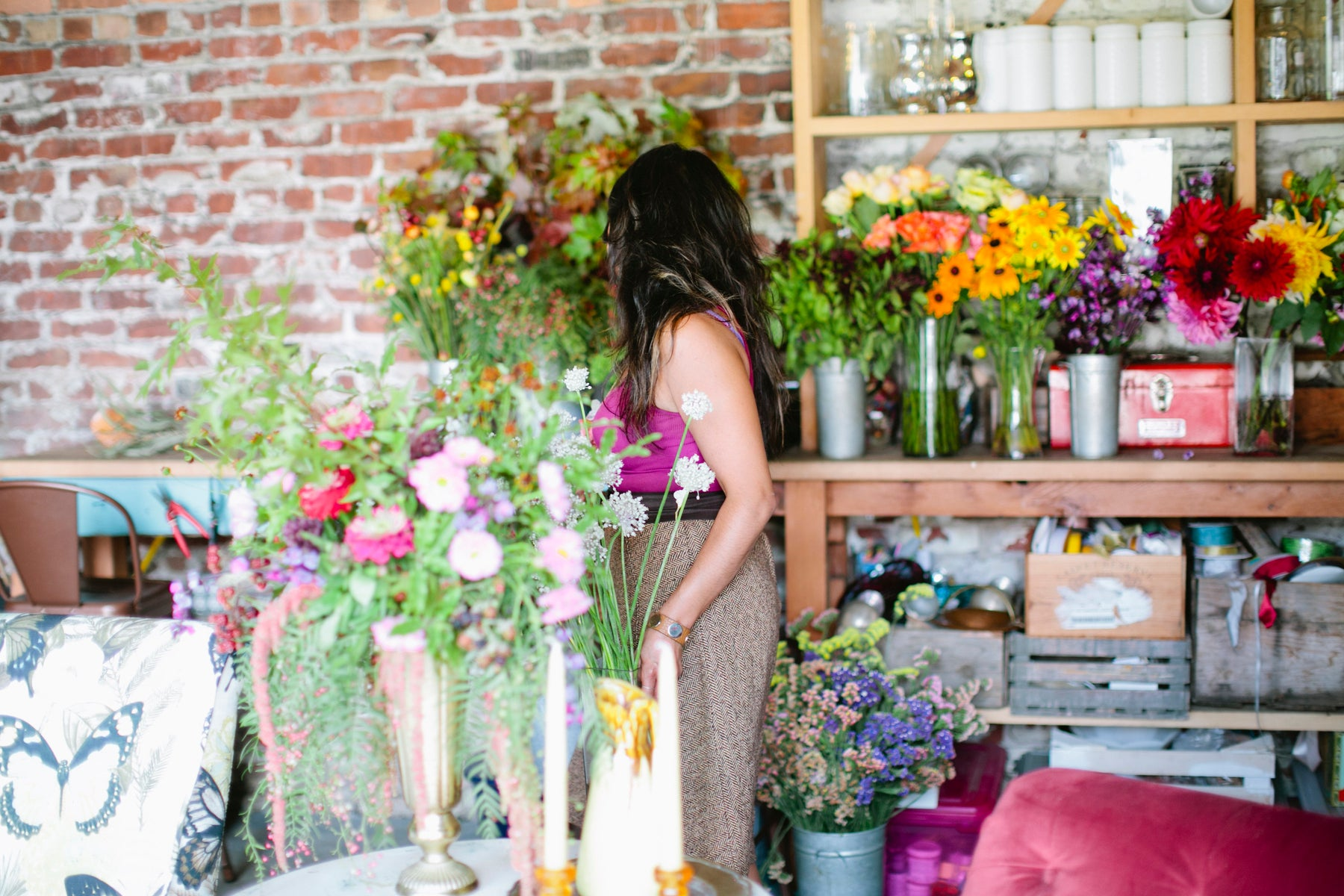 Pilar in her Studio in Oakland with a variety of Local grown and Organic flowers from the SF Bay Area
