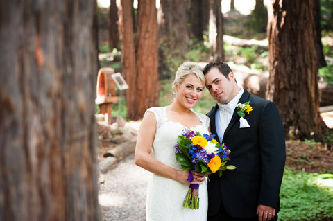 The wedding couple in the Redwood Grove flowers by Gorgeous and Green