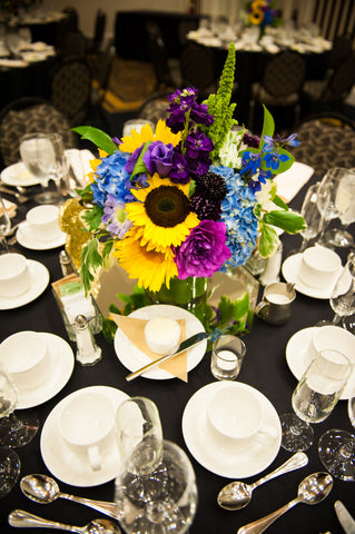 colorful centerpiece with sunflowers by Gorgeous and Green at Hotel Shattuck