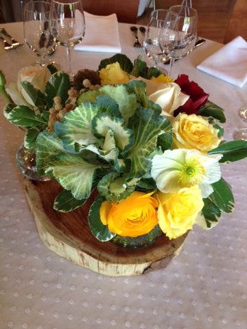 centerpiece of local grown and organic ranunculus by Gorgeous and Green