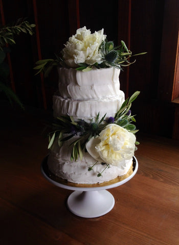 Wedding cake with white peonies and olive by Gorgeous and Green