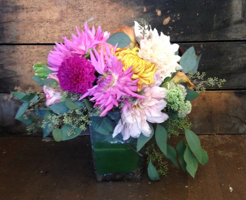 modern centerpiece with organic feel, cafe au lait and pink dahlias, garden roses, mums by Gorgeous and Green