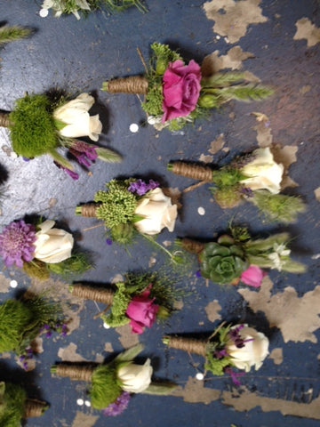 various boutonnieres for a wedding by Gorgeous and green, 20 in all!