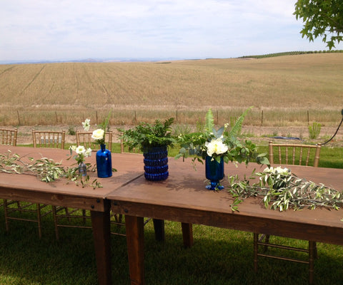cobalt blue glassware with olive and white blooms for reception tables by Gorgeous and Green