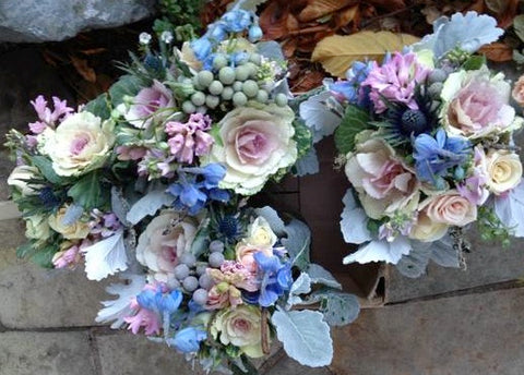 Centerpieces and bridesmaid bouquets in pinks and blues and silver by Gorgeous and Green