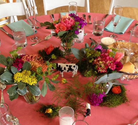Colorful and wild centerpiece with animals for wedding at the Brazilian Room, florals by Gorgeous and Green