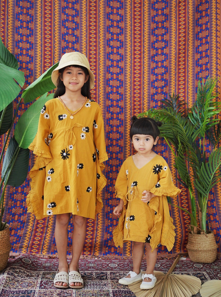 resort kids fashion, kids fashion, resort wear, kaftan, tunic, caftan, daisy boo, daisy, mustard, frills, give back