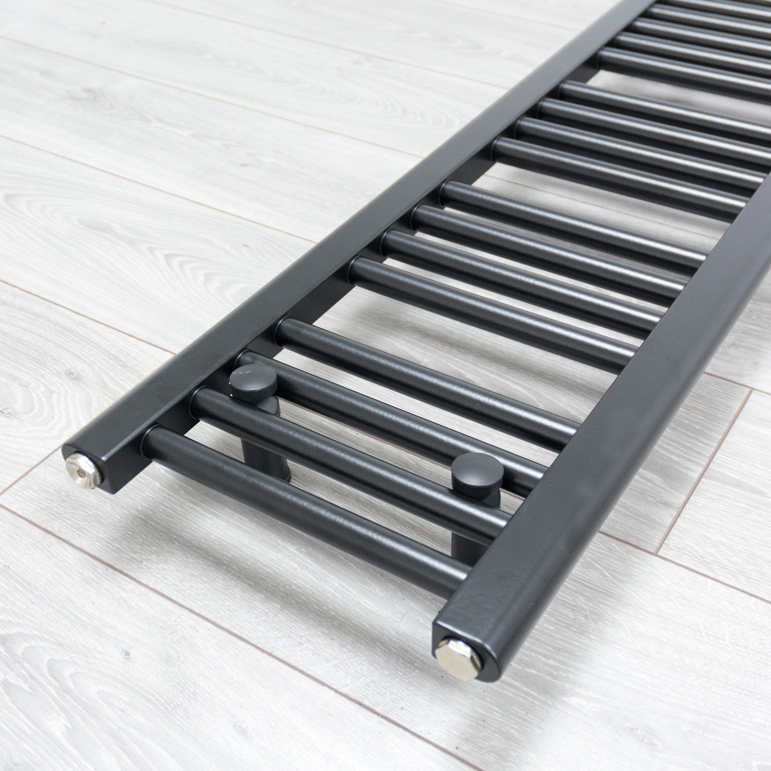 300mm x 1600mm Black Heated Towel Rail Radiator Close Up Image