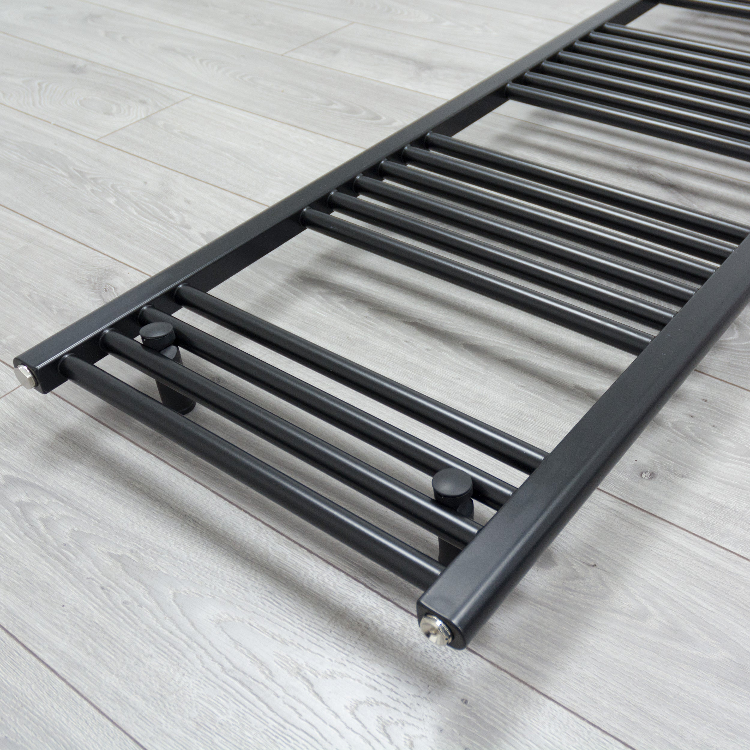400mm x 1400mm Black Heated Towel Rail Radiator Close Up Image