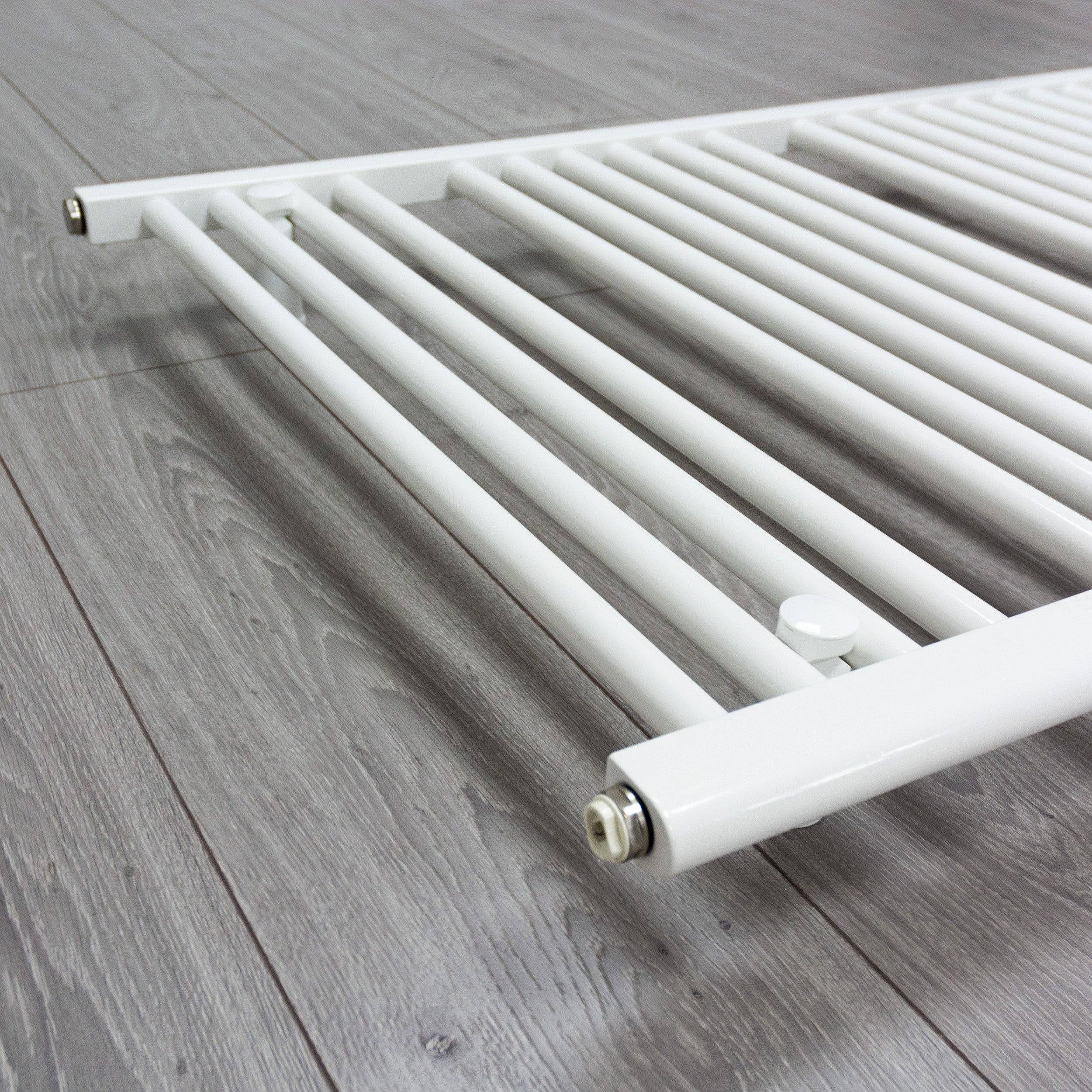 700mm x 1500mm White Heated Towel Rail Radiator Close Up Image