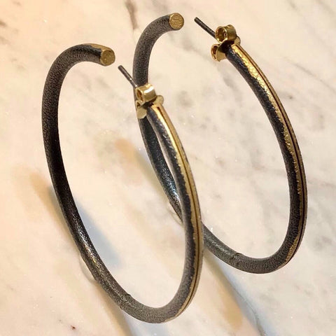 Textured gold tone and Oxidised silver hoops