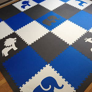 Kids' Playroom with Safari Animals Foam Mats in Blue, Gray, and White- D127