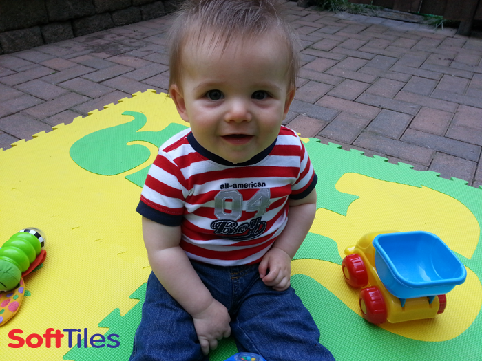 SoftTiles Safari Animals Playmat used on a brick patio