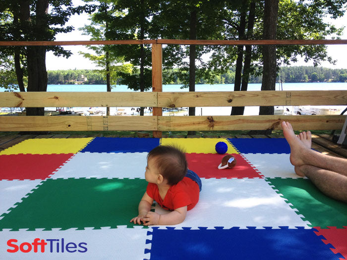 SoftTiles Play Mats for Kids used on an outdoor wooden deck