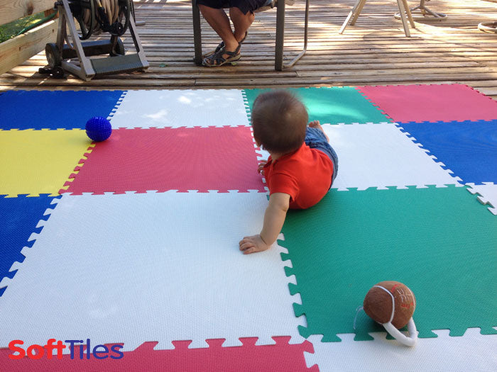 SoftTiles Foam Mats used to create a cushioned area on an outdoor deck