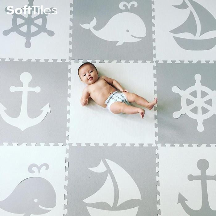 Baby relaxing on SoftTiles Nautical Theme Foam Playmat